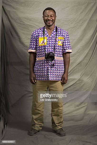 Ibrahim years old from Niger poses during SAFEM Salon international de l'artisanat pour la femme trade fair on December 09 2013 in Niamey Niger Her...
