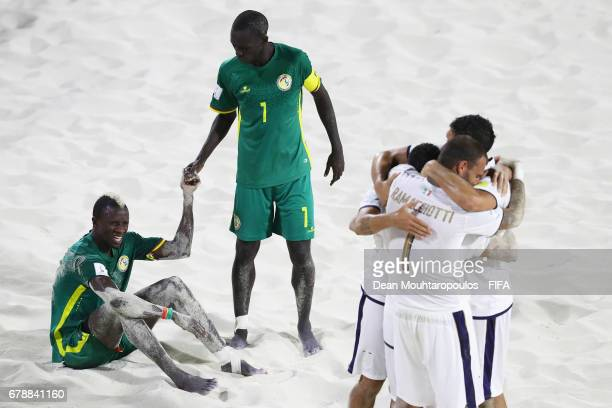 Ibrahima Balde and Babacar Fall of Senegal look dejected as Michele Di Palma Matteo Marrucci and Dario Ramacciotti of Italy celbrate after the FIFA...