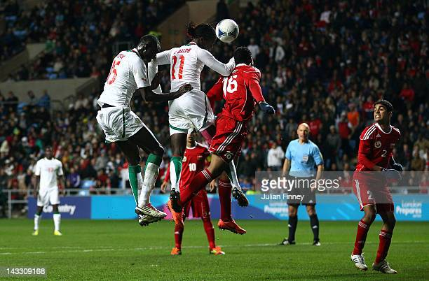 Ibrahima Balde heads for goal during the London 2012 Olympic Qualifier match between Senegal and Oman at the Ricoh Arena on April 23 2012 in Coventry...