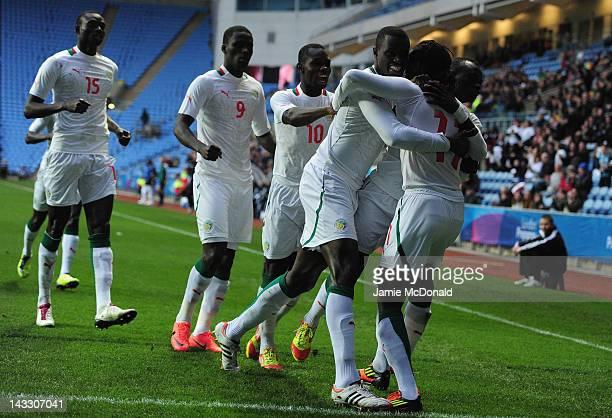 Ibrahima Balde of Senagal celebrates his goal during the London 2012 Olympic Qualifier between Senegal and Oman at Ricoh Arena on April 23 2012 in...