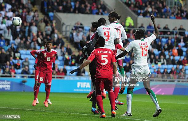 Ibrahima Balde of Senagal scores a goal during the London 2012 Olympic Qualifier between Senegal and Oman at Ricoh Arena on April 23 2012 in Coventry...