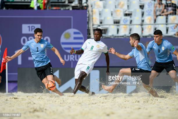 Ibrahima Balde of Senegal and Facundo Cordero of Uruguay in action during the FIFA Beach Soccer World Cup 2021 group D match between Senegal and...