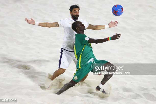 Ibrahima Balde of Senegal battles for the ball with Alfioluca Chiavaro of Italy during the FIFA Beach Soccer World Cup Bahamas 2017 quarter final...