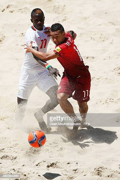 Ibrahima Balde of Senegal battles for the ball with Be of Portugal during the Group A FIFA Beach Soccer World Cup match between Senegal and Portugal...