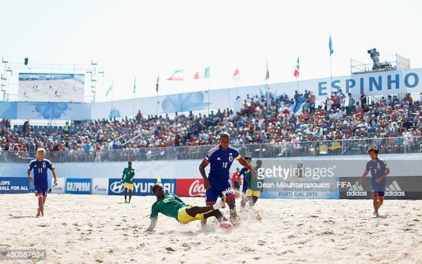 Ibrahima Balde of Senegal battles for the ball with Ozu Moreira of Japan during the Group A FIFA Beach Soccer World Cup match between Japan and...