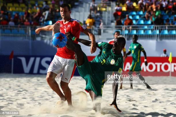 Ibrahima Balde of Senegal battles for the ball with Sandro Spaccarotella of Switzerland during the FIFA Beach Soccer World Cup Bahamas 2017 group A...