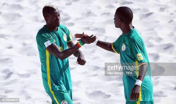 Ibrahima Balde of Senegal celebrates a goal with team mate Ibra Thioune during the FIFA Beach Soccer World Cup Bahamas 2017 group A match between...