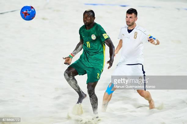 Ibrahima Balde of Senegal competes for the ball with Francesco Corosiniti of Italy during the FIFA Beach Soccer World Cup Bahamas 2017 quarter final...