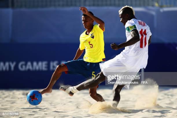 Ibrahima Balde of Senegal shoots on goal in front of Jose Vera of Ecuador during the FIFA Beach Soccer World Cup Bahamas 2017 group A match between...