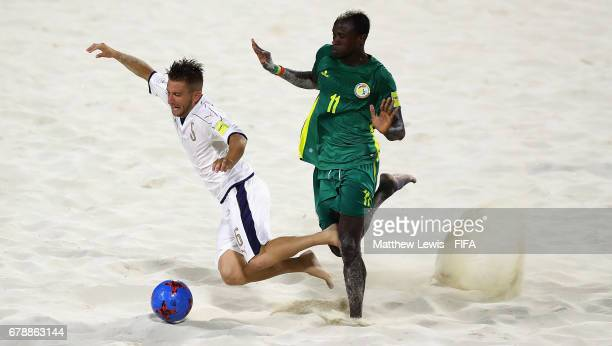 Ibrahima Balde of Senegal tackles Simone Marinai of Italy during the FIFA Beach Soccer World Cup Bahamas 2017 quarter final match between Italy and...
