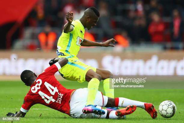 Ibrahima Cisse of Standard Liege tackles Kalifa Coulibaly of KAA Gent during the Belgian Jupiler Pro League match between Royal Standard de Liege and...