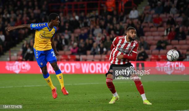 Ibrahima Diallo of Southampton scores their team's first goal while Jayden Bogle of Sheffield United looks on during the Carabao Cup Third Round...