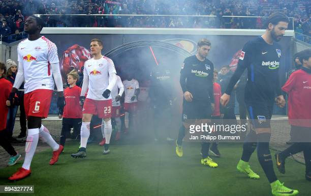 Ibrahima Konate Marcel Halstenberg of RB Leipzig Alexander Esswein and Marvin Plattenhardt of Hertha BSC before the game between RB Leipzig and...