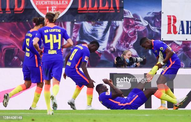 Ibrahima Konate of Leipzig celebrates his team's first goal with teammates during the Bundesliga match between RB Leipzig and Sport-Club Freiburg at...
