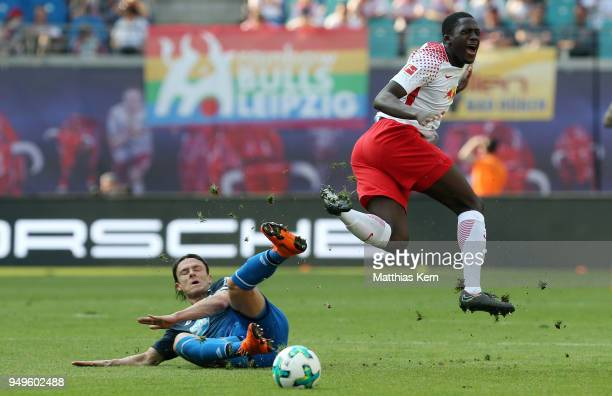 Ibrahima Konate of Leipzig is attacked by Nico Schulz of Hoffenheim during the Bundesliga match between RB Leipzig and TSG 1899 Hoffenheim at Red...