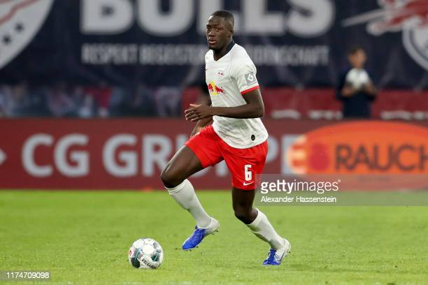 Ibrahima Konate of Leipzig runs with the ball during the Bundesliga match between RB Leipzig and FC Bayern Muenchen at Red Bull Arena on September...