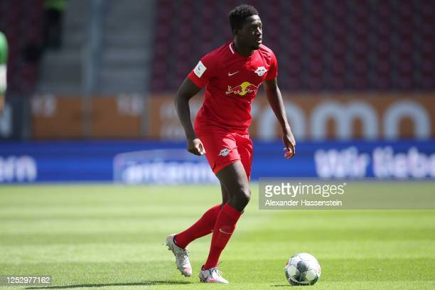 Ibrahima Konate of Leipzig runs with the ball during the Bundesliga match between FC Augsburg and RB Leipzig at WWK-Arena on June 27, 2020 in...