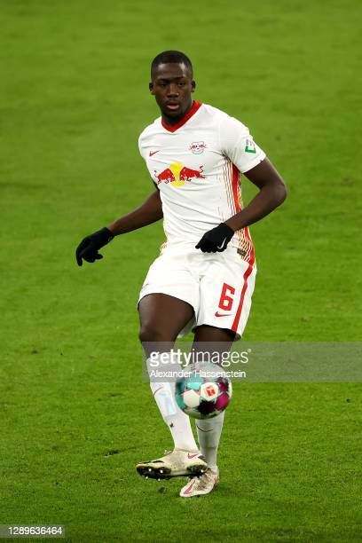 Ibrahima Konate of Leipzig runs with the ball during the Bundesliga match between FC Bayern Muenchen and RB Leipzig at Allianz Arena on December 05,...