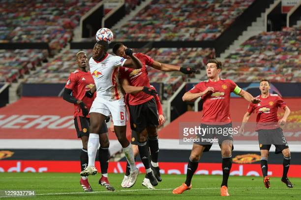 Ibrahima Konate of RB Leipzig and Anthony Martial of Manchester United battle for the ball during the UEFA Champions League Group H stage match...