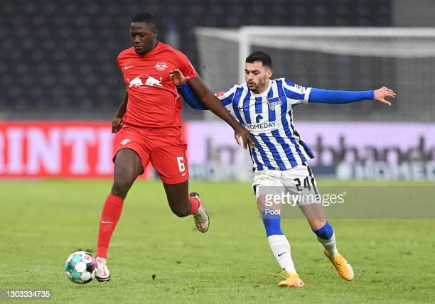 Ibrahima Konate of RB Leipzig battles for possession with Nemanja Radonjic of Hertha BSC during the Bundesliga match between Hertha BSC and RB...