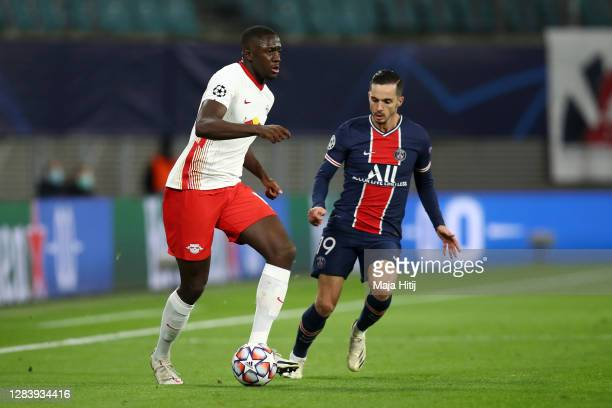 Ibrahima Konate of RB Leipzig battles for possession with Pablo Sarabia of Paris Saint-Germain during the UEFA Champions League Group H stage match...
