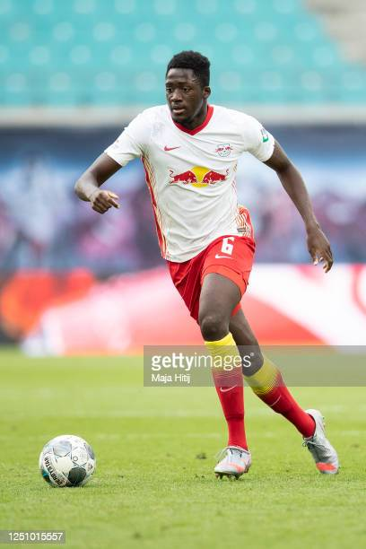 Ibrahima Konate of RB Leipzig controls the ball during the Bundesliga match between RB Leipzig and Borussia Dortmund at Red Bull Arena on June 20,...