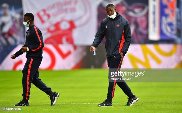 Ibrahima Konate of RB Leipzig looks on during a pitch inspection prior to the Bundesliga match between RB Leipzig and SV Werder Bremen at Red Bull...