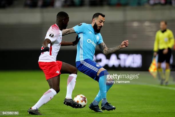 Ibrahima Konate of RB Leipzig vies with Kostas Mitroglou of Olympique Marseille during the UEFA Europa League quarter final leg one match between RB...