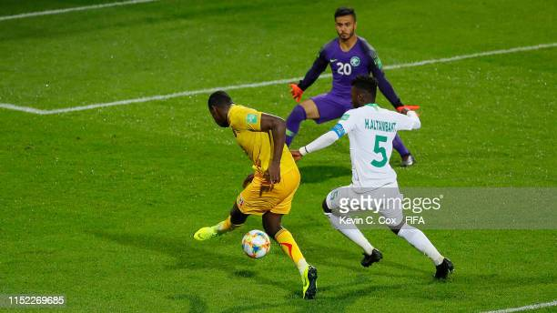 Ibrahima Kone of Mali scores his team's second goal past Hassan Altambakti of Saudi Arabia and Abdulrahman Alshammari of Saudi Arabia during the 2019...