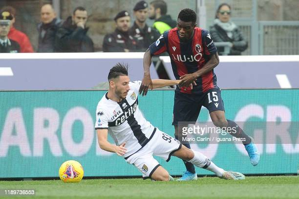 Ibrahima Mbaye of Bologna FC comptetes the ball with Mattia Sprocati of Parma Calcio during the Serie A match between Bologna FC and Parma Calcio at...