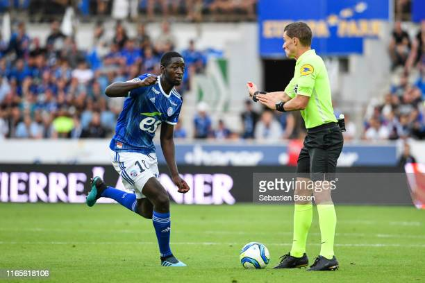 Ibrahima Sissoko of Strasbourg and Willy Delajod referee during the Ligue 1 match between Strasbourg and Monaco at Stade de la Meinau on September 1...