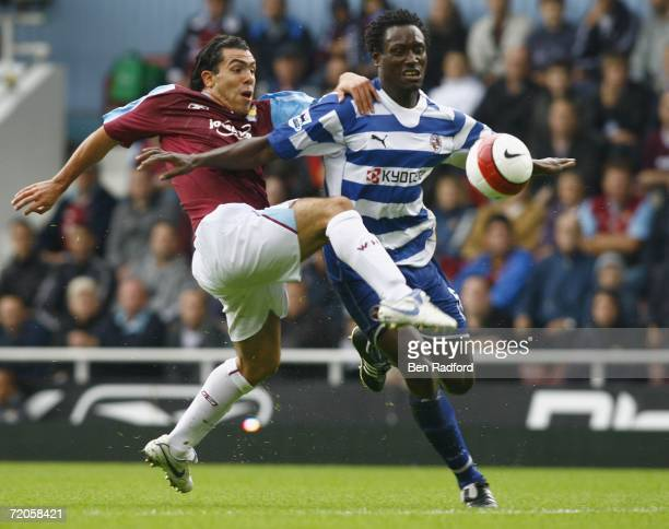 Ibrahima Sonko of Reading holds off Carlos Tevez of West Ham United during the Barclays Premiership match between West Ham United and Reading at...