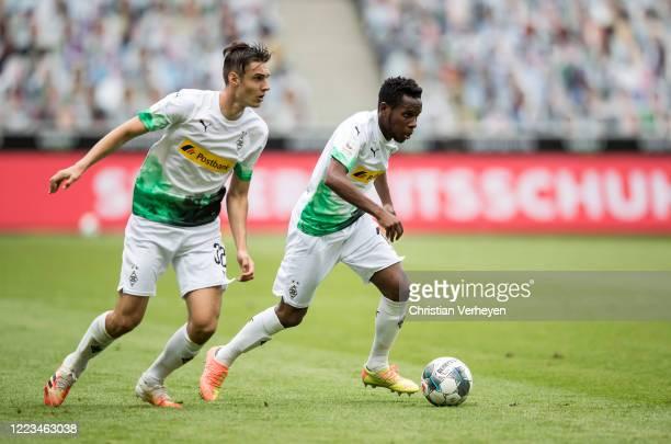 Ibrahima Traore and Florian Neuhaus of Borussia Moenchengladbach in action during the Bundesliga match between Borussia Moenchengladbach and Hertha...