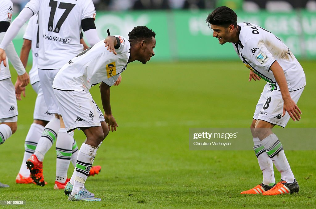 Ibrahima Traore and Mahmoud Dahoud of Borussia Moenchengladbach celebrate after the first goal during the Bundesliga match between Borussia Moenchengladbach and Hannover 96 at Borussia-Park on November 21, 2015 in Moenchengladbach, Germany