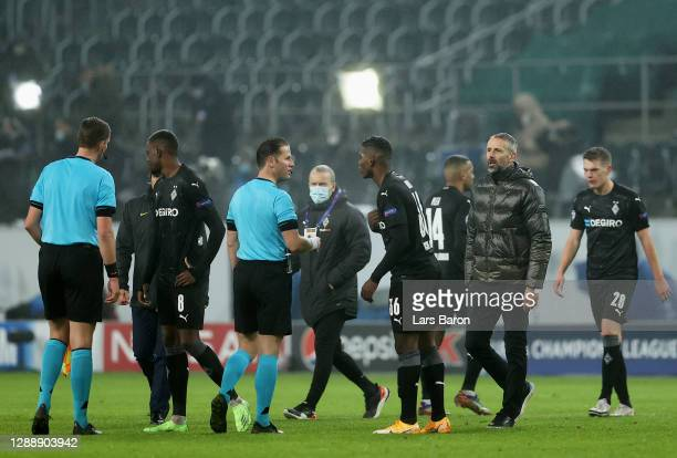 Ibrahima Traore and Marco Rose, Head Coach of Borussia Moenchengladbach argue with referee Danny Makkelie after the UEFA Champions League Group B...