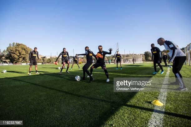 Ibrahima Traore and Raffael of Borussia Moenchengladbach battle for the ball during the Borussia Moenchengladbach Training Camp on January 06 2020 in...