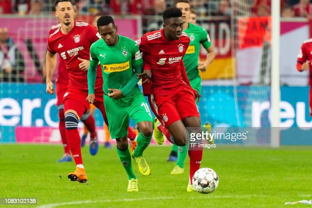 Ibrahima Traore of Borussia Moenchengladbach and Alphonso Davies of Bayern Muenchen battle for the ball during the Telekom Cup 2019 Final between FC...