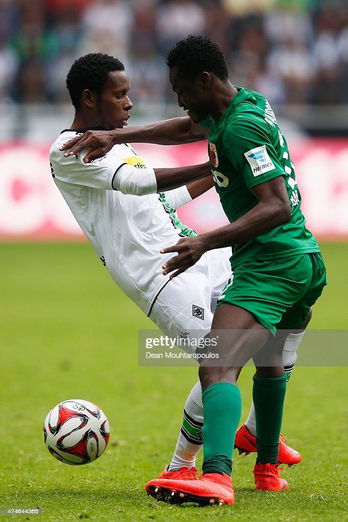 Ibrahima Traore of Borussia Moenchengladbach and Baba Rahman of FC Augsburg battle for the ball during the Bundesliga match between Borussia Moenchengladbach and FC Augsburg held at Borussia Park Stadium on May 23, 2015 in Moenchengladbach, Germany.