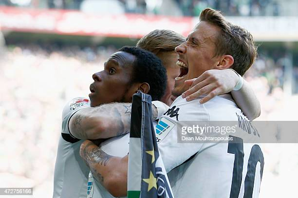 Ibrahima Traore of Borussia Moenchengladbach celebrates scoring the third goal of the game with team mates during the Bundesliga match between...