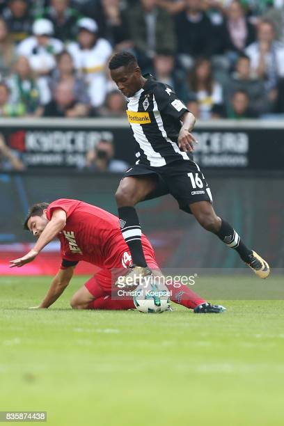 Ibrahima Traore of Moenchengladbach and Jonas Hector of Koeln during the Bundesliga match between Borussia Moenchengladbach and 1 FC Koeln at...