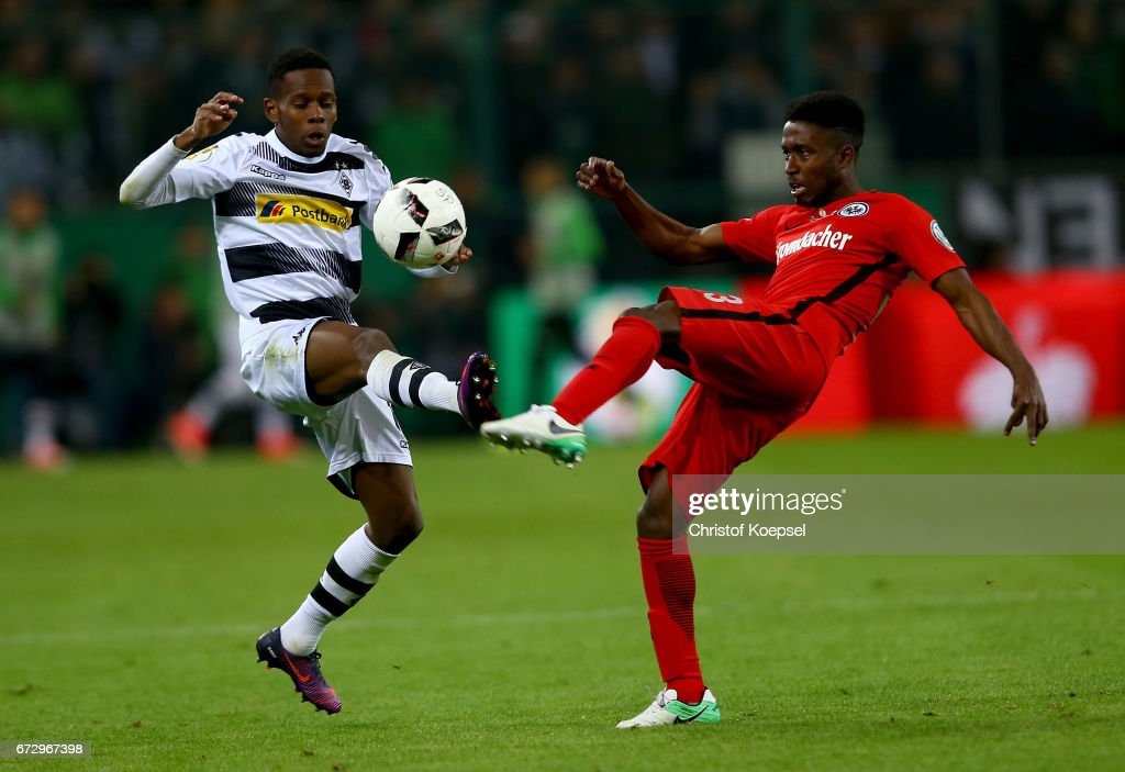 Ibrahima Traore (L) of Moenchengladbach and Talb Tawatha of Frankfurt battle for the ball during the DFB Cup semi final match between Borussia Moenchengladbach and Eintracht Frankfurt at Borussia-Park on April 25, 2017 in Moenchengladbach, Germany.