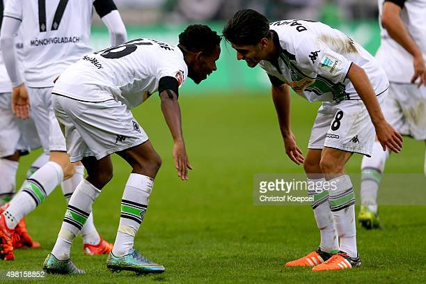 Ibrahima Traore of Moenchengladbach celebrates the first goal with Mahmoud Dahoud during the Bundesliga match between Borussia Moenchengladbach and...