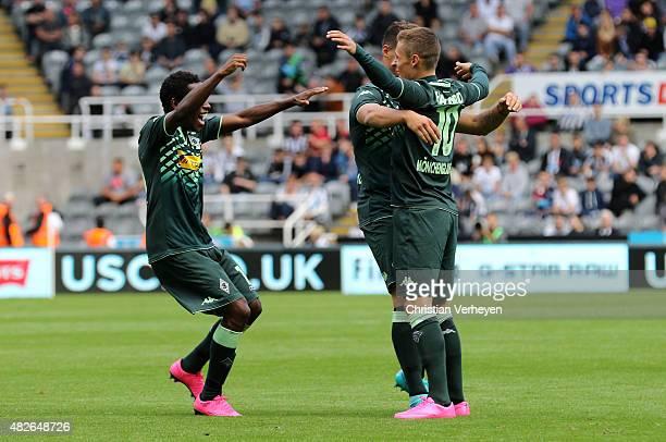 Ibrahima Traore, Thorgan Hazard Granit Xhaka of Borussia Moenchengladbach celebrate after their first goal during the friendly match between...