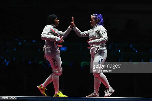 Ibtihaj Muhammad and Dagmara Wozniak of the United States highfive during the Women's Sabre Team bronze medal match between United States and Italy...