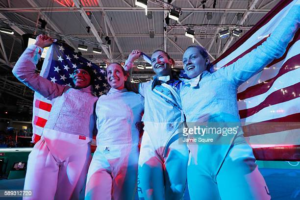Ibtihaj Muhammad Mariel Zagunis Monica Aksamit and Dagmara Wozniak of the United States celebrate winning bronze during the Women's Sabre Team bronze...