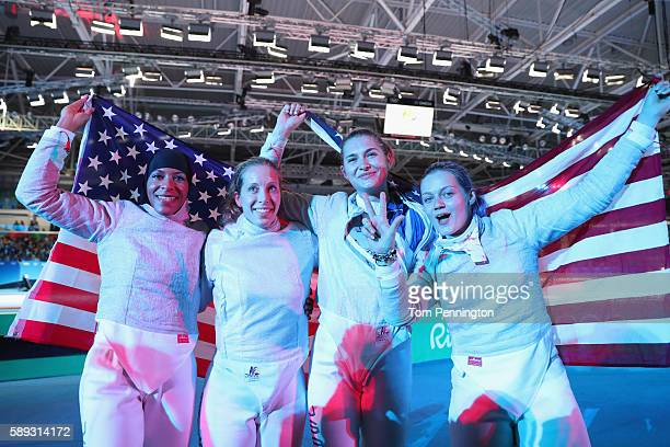 Ibtihaj Muhammad Mariel Zagunis Monica Aksamit and Dagmara Wozniak of the United States celebrate winning the Women's Sabre Team bronze medal match...