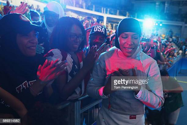 Ibtihaj Muhammad of the United States celebrates after the United States wins the Women's Sabre Team bronze medal match between United States and...