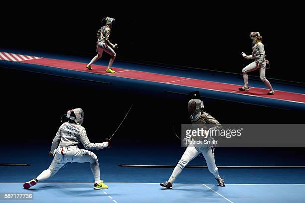 Ibtihaj Muhammad of the United States competes against Cecilia Berder of France during the Women's Individual Sabre on Day 3 of the Rio 2016 Olympic...