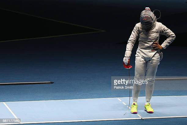 Ibtihaj Muhammad of the United States look dejected after defeat to Cecilia Berder of France during the Women's Individual Sabre on Day 3 of the Rio...