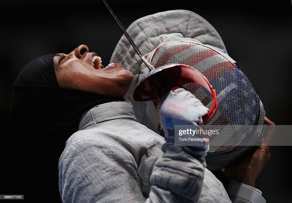 Ibtihaj Muhammad of the United States reacts against Sofya Velikaya of Russia during the Women's Sabre Team Semifinal 1 Russia vs United States at Carioca Arena 3 on August 13, 2016 in Rio de Janeiro, Brazil.
